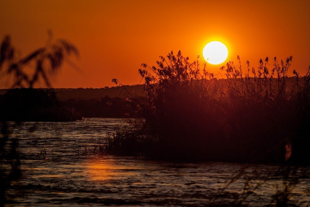 You really can't have enough pictures of African sunsets.  This is another sunset over Zambia and the Zambezi River.