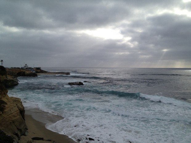 Rays of light from the clouds during an overcast afternoon at La Jolla Cove outside of San Diego, California.