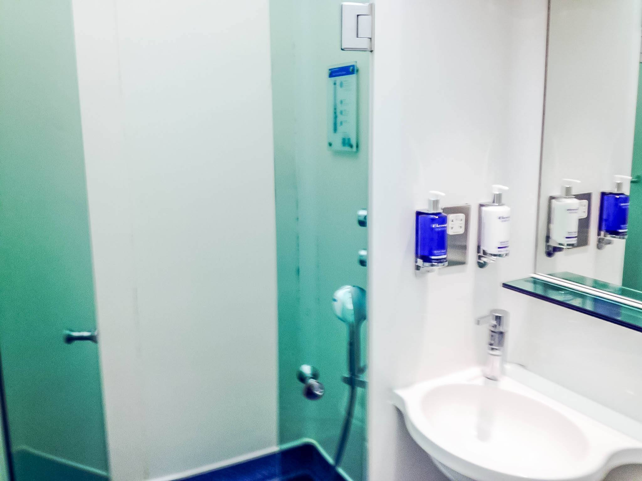 The shower cabinet in the British Airways lounge.  These BA Lounge Heathrow Terminal 5 Showers are basic, but clean and convenient making them our favorite Heathrow airport shower.