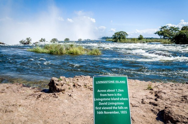 The sign at Victoria Falls alerting visitors to where Livingstone Island is located.  It is not possible to visit the island during high water season.