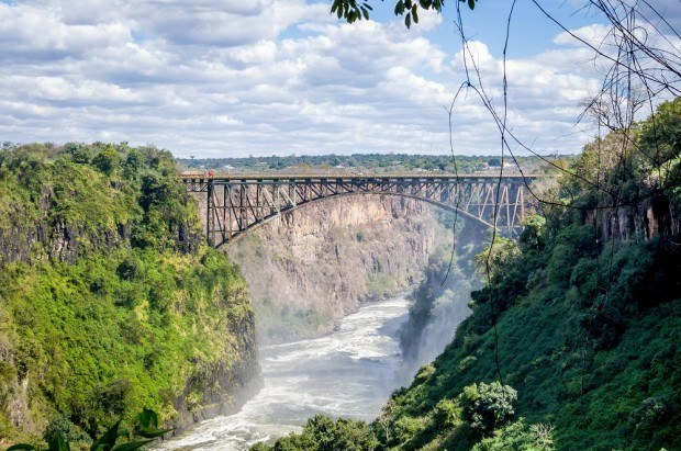 The Victoria Falls Bridge is built over the second gorge and connects Livingstone, Zambia with Zimbabwe