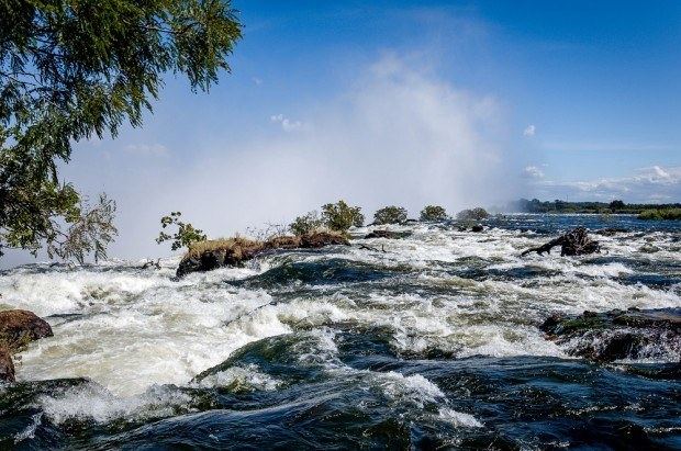 The rain-swollen Zambezi River right at the top of Victoria Falls on the Livingstone, Zambia side.