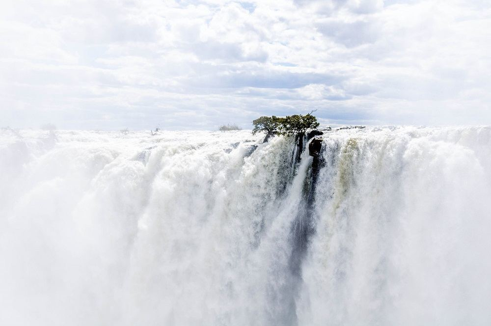 Visiting Victoria Falls Livingstone, Zambia side at peak flow is like being in a cloud or a shower - it's a total whiteout.