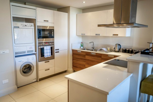 The kitchen at the Lawhill Luxury Apartments, complete with washing machine and dryer.