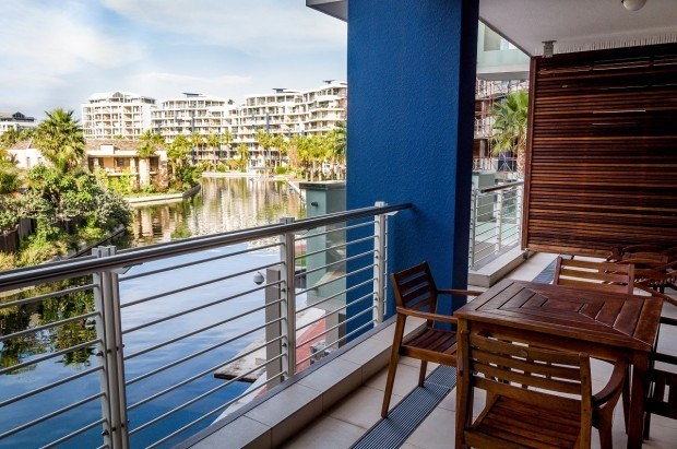 The terrace at the Lawhill Luxury Apartments Cape Town, overlooking the V&A Waterfront canal.
