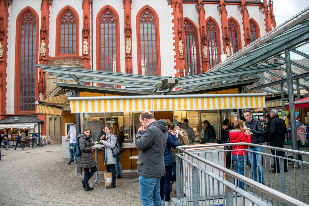 In the main Market Square of Wurzburg, the Bratwurststand Knüpfing has been serving delicious bratwurst and sausage to locals for decades.  At any time of day, you'll find a line for their franks and Winzerbratwurst.