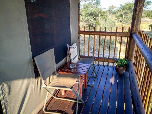 Each chalet at nThambo Tree Camp has a private deck and sitting area.