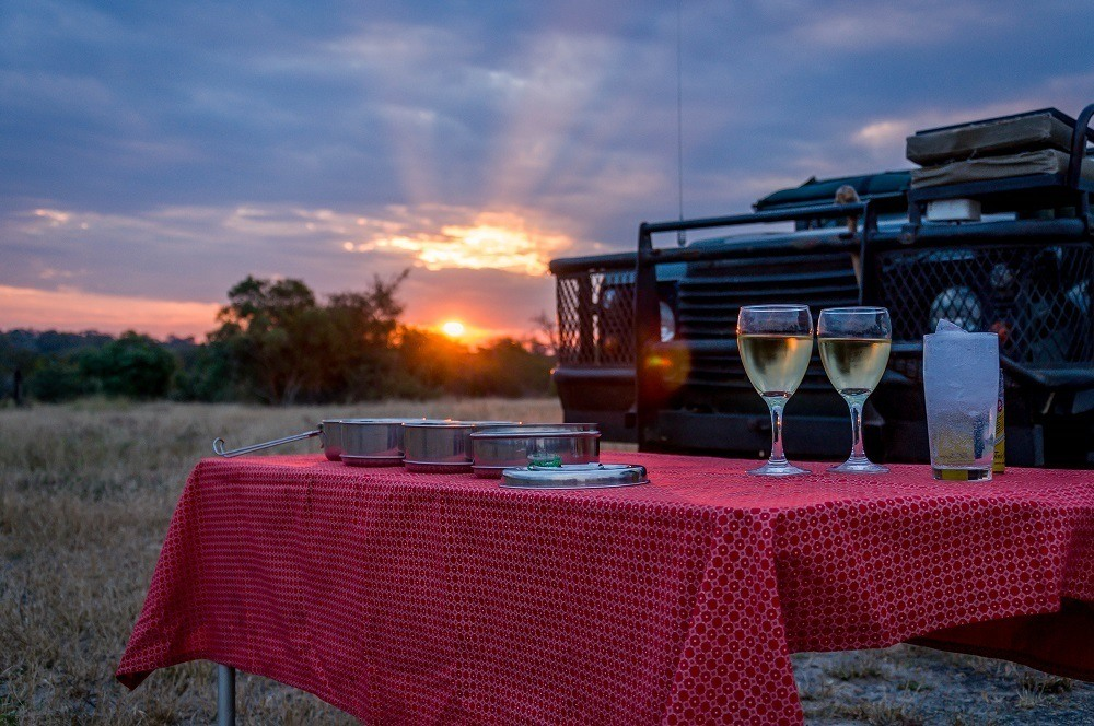 Taking a break on safari at nThambo Tree Camp to enjoy wines from South Africa's Creation Winery.