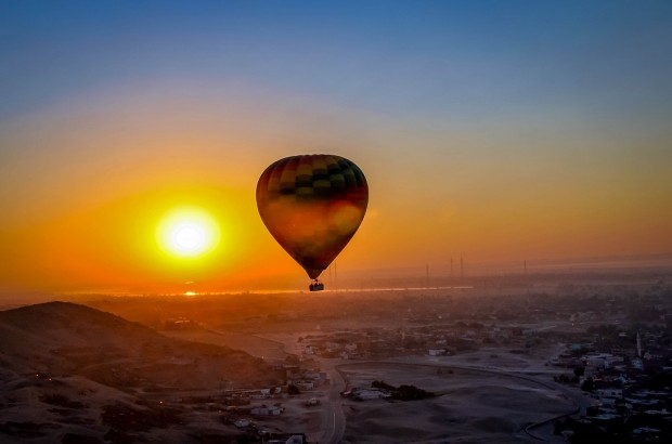 Sunrise over Egypt's Valley of the Kings from a hot air balloon.