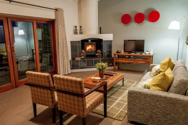 The living room with fireplace in our Grootbos Garden Lodge luxury suite. The Grootbos reviews we read said the accommodations would be large, but we were unprepared for just how spacious the rooms would be. Grootbos is one of the best resorts in south Africa.