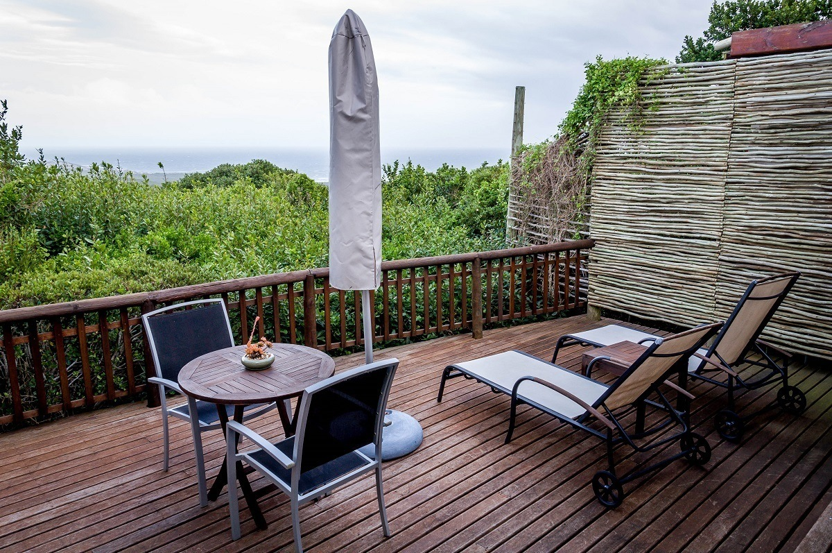 The deck in our luxury suite at the Grootbos Private Nature Reserve with views of fynbos and Milkwood forest, with the Atlantic Ocean in the distance.