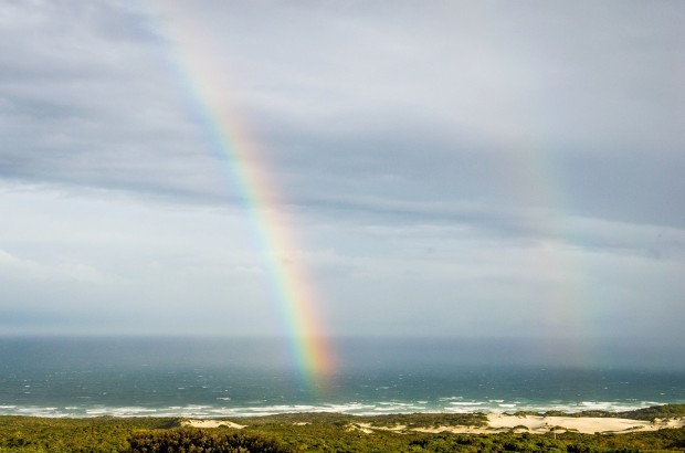 An unusual double rainbow over Walker Bay as viewed from the Grootbos Garden Lodge.