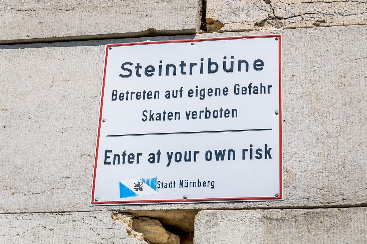 Enter at your own risk sign at the Steintribune at the Nazi Rally Party Grounds.