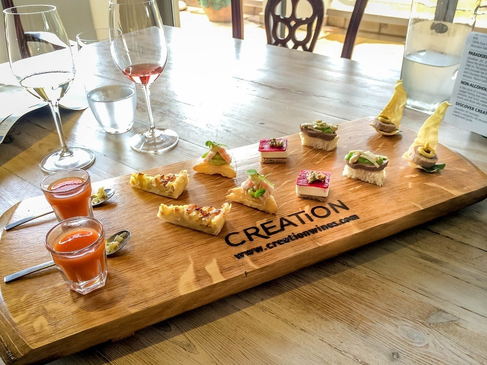 Canapes and wine -- visiting the country's wineries is a fun part of a South Africa itinerary