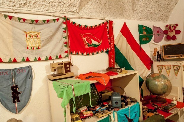 The flags of communist youth organizations in a child's room on our Hammer and Sickle Tour Budapest.