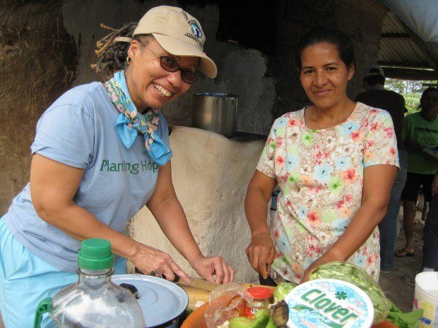 Representatives from Sustainable Harvest International get their hands dirty in the communities where they serve.