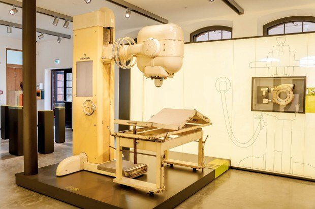Early radiation therapy equipment for cancer patients at the Siemens Healthineers MedMuseum in Erlangen, Germany.