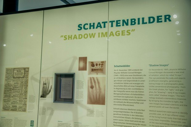 Panel at the Siemens Med Museum in Erlangen explaining X-ray Shadow Images; discovered by Wilhelm Conrad Röntgen on November 8, 1895.