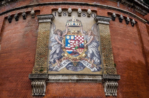Coat of arms at the base of Castle Hill and the funicular in Budapest, Hungary.  Riding the funicular is on the top things to do when visiting Budapest.