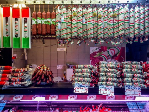 Sampling the sausages, salami and charcuterie while visiting Budapest's Central Market.