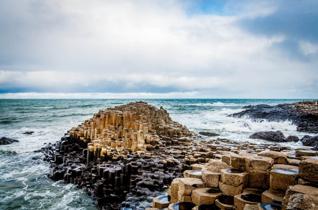 The iconic basalt columns of The Giant's Causeway in Antrim, Northern Ireland. This is the highlight of the Causeway Coastal Route.