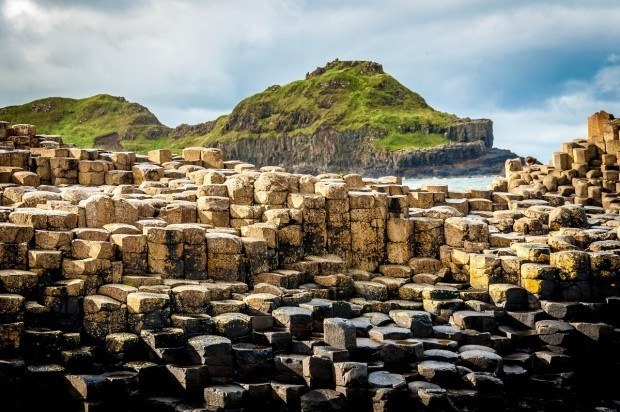 The Giant's Causeway on the Antrim Coast Road in Northern Ireland. The Giant Causeway Coast Ireland is a completely unique place full of caves, castles, and coastal rock formations. Best of all, getting from Belfast to Giant's Causeway is an easy drive, making this among the best things to do in Northern Ireland.