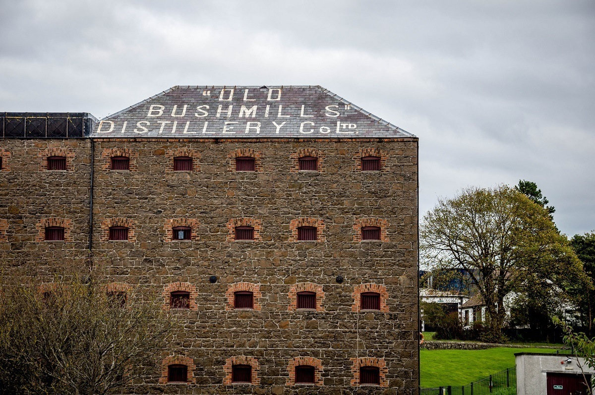 A grain building at the Old Bushmills Distillery in Northern Ireland.  For many visitors, this is a highlight of the Causeway Coastal Route and one of the top Northern Ireland sights.