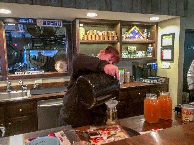 Mixing and crafting the apple pie cocktails at Blaum Bros Distillery in Galena.