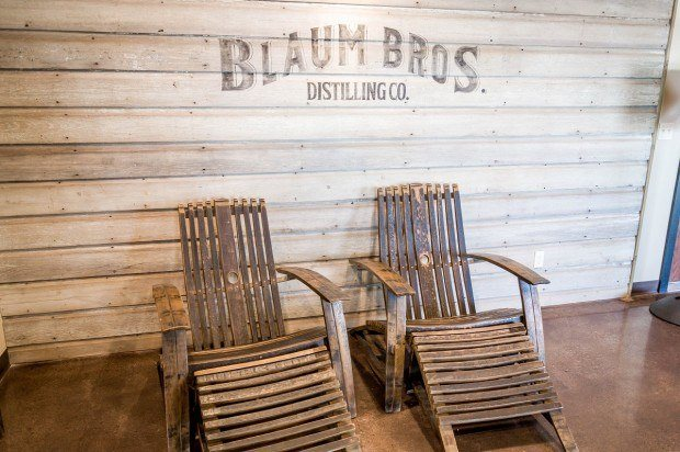 Wooden chairs on the porch at Blaum Bros. Distillery in Galena.