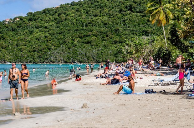 Masses of cruise ship visitors come to Magens Bay Beach and congregate near the concession stand.