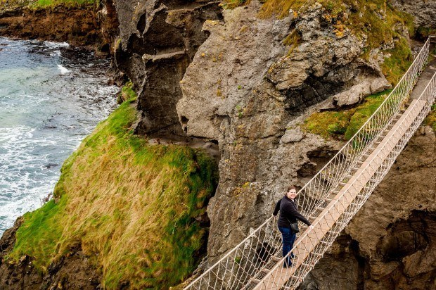 Venturing out on the Antrim Coast Road's Carrick-a-Rede rope bridge.