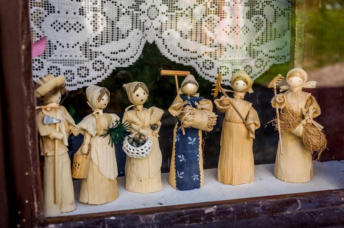 Dolls in a window in Vlkolinec, Slovakia.