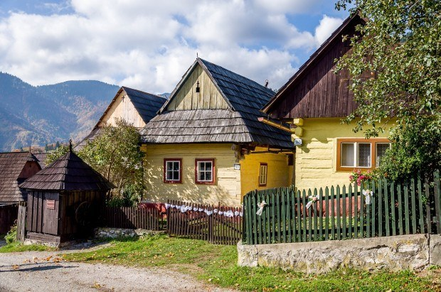 A few yellow homes in the rural village of Vlkolinec, Slovakia - a UNESCO World Heritage Site in the Carpathian Mountains.