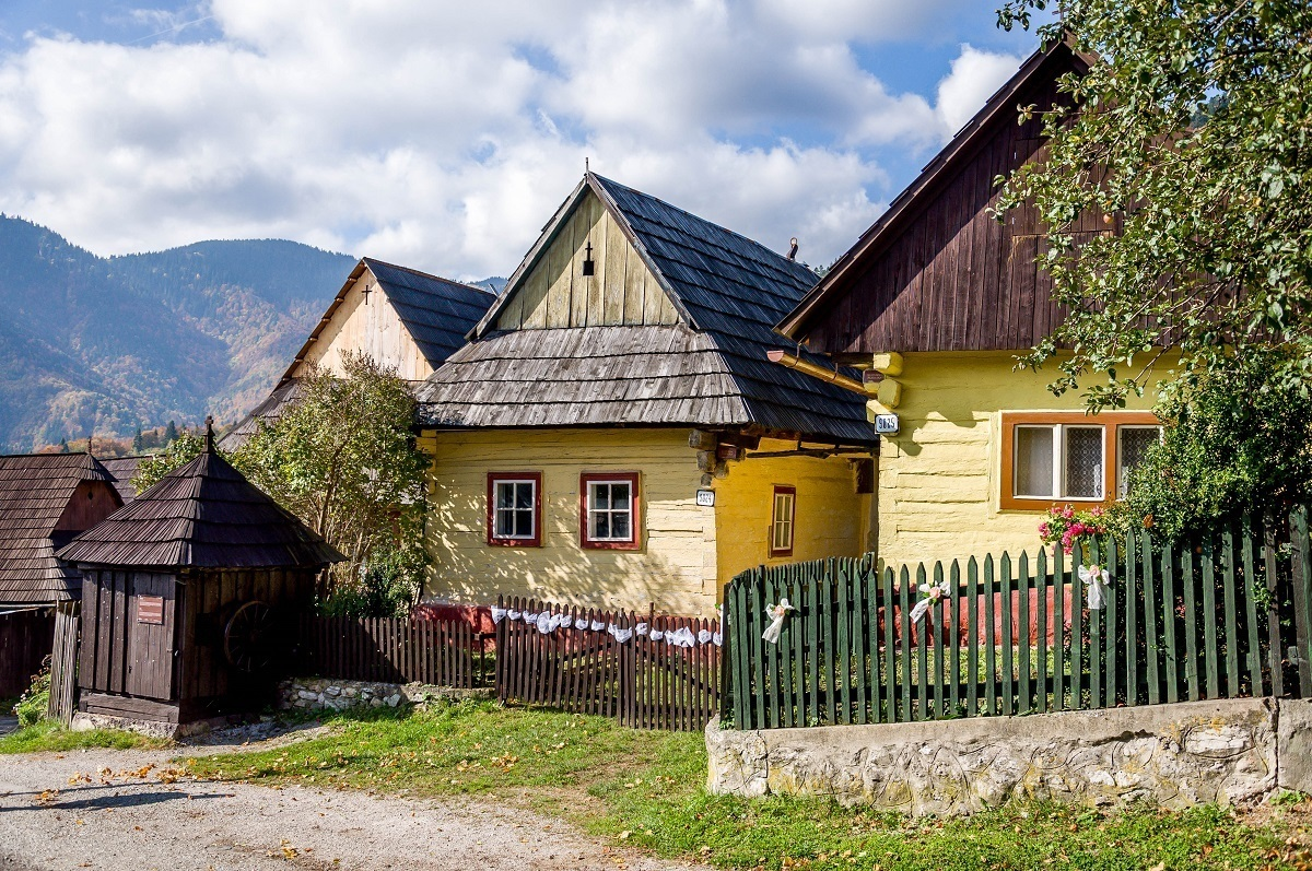 A few yellow homes in the rural village of Vlkolinec, Slovakia
