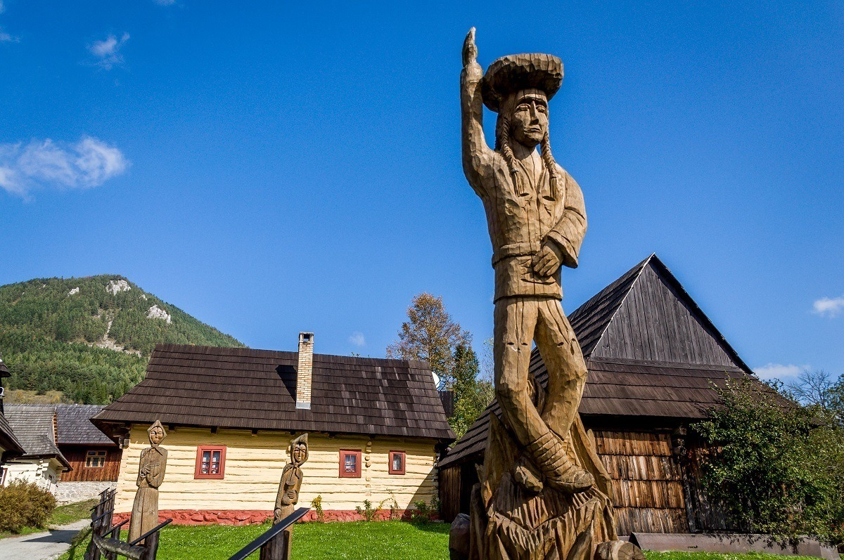 A statue welcomes visitors to the rural village of Vlkolinec, Slovakia.
