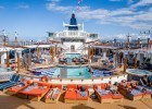 The outdoor pool deck on a Celebrity Summit cruise.