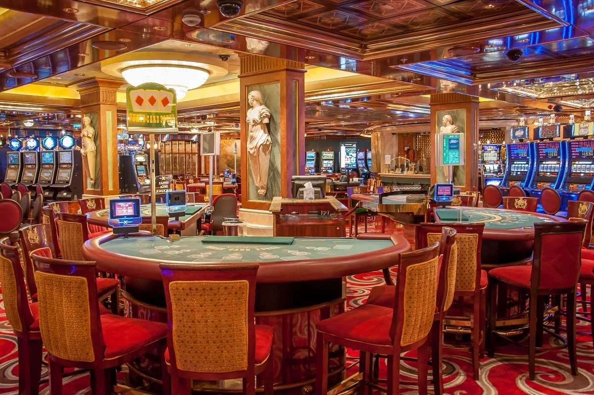 Card tables and slot machines inside the Celebrity Summit casino