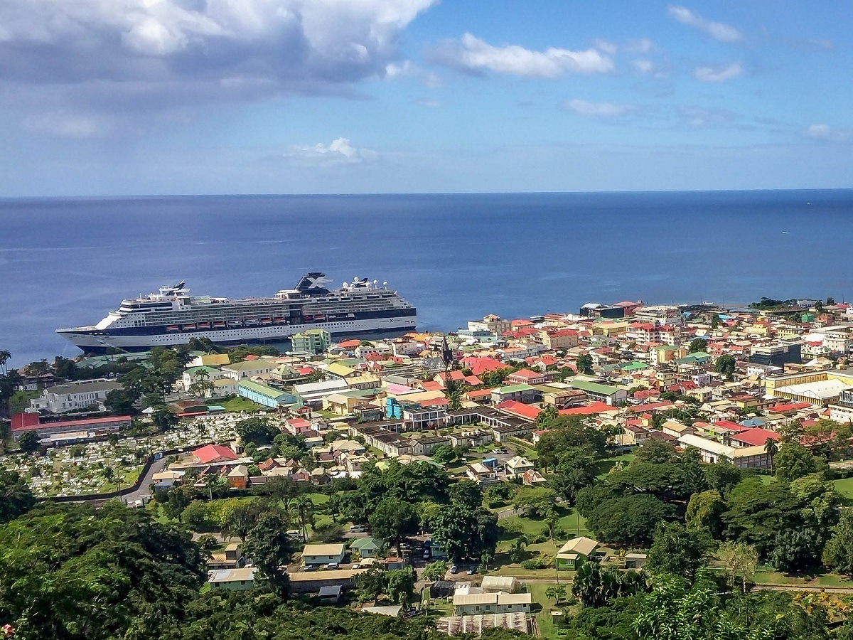 Celebrity Summit ship docked beside the buildings of Roseau, Dominica