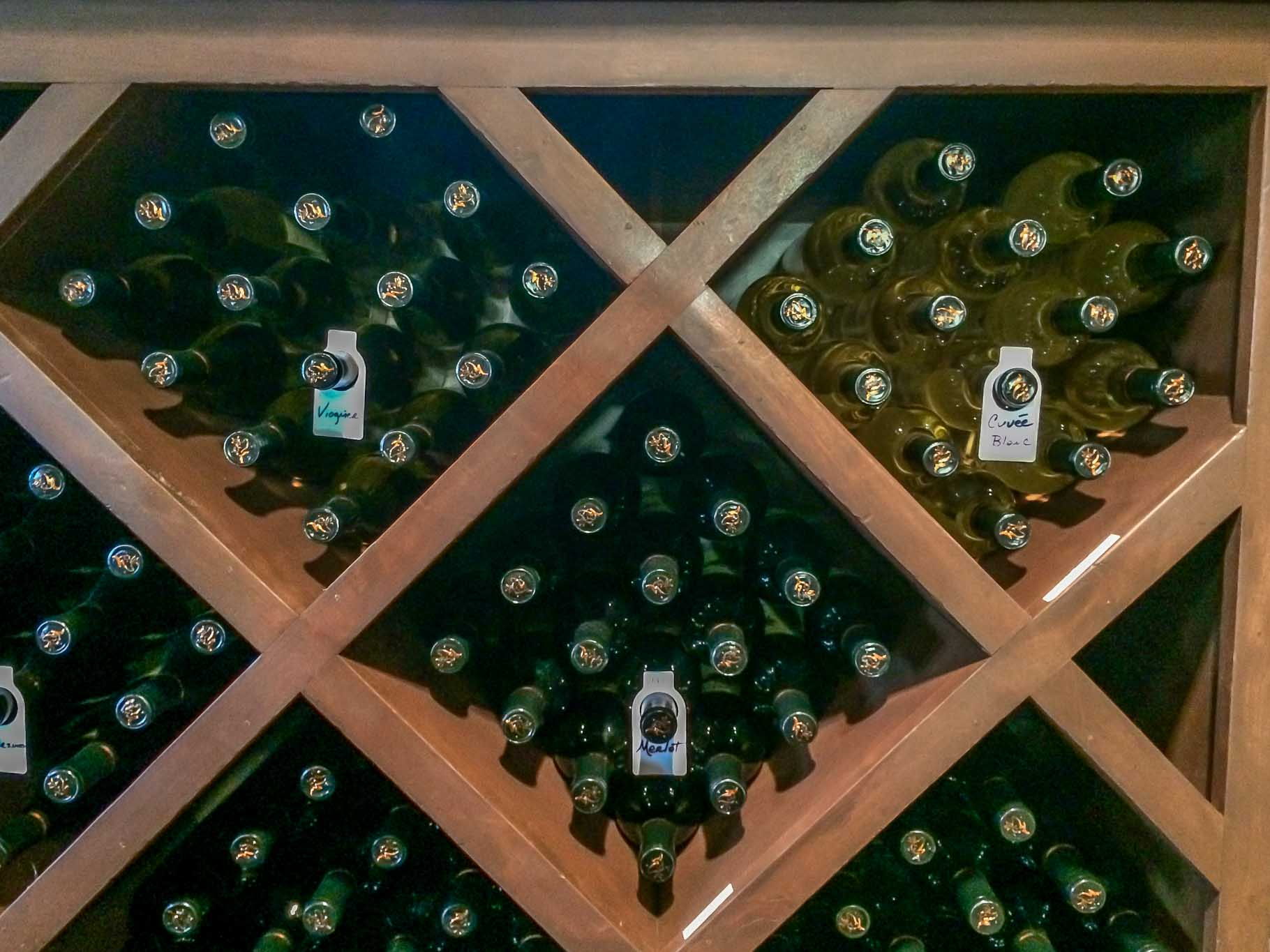 Bottle display at Grape Creek, one of the top Fredericksburg TX wineries