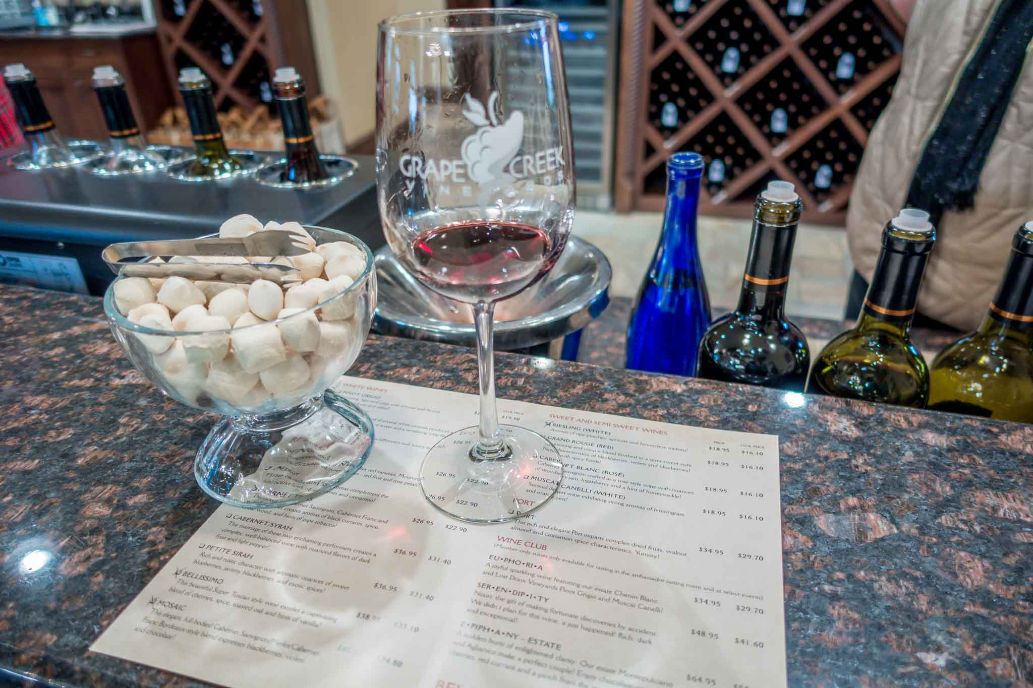 Wine glass and tasting menu at Grape Creek Vineyards
