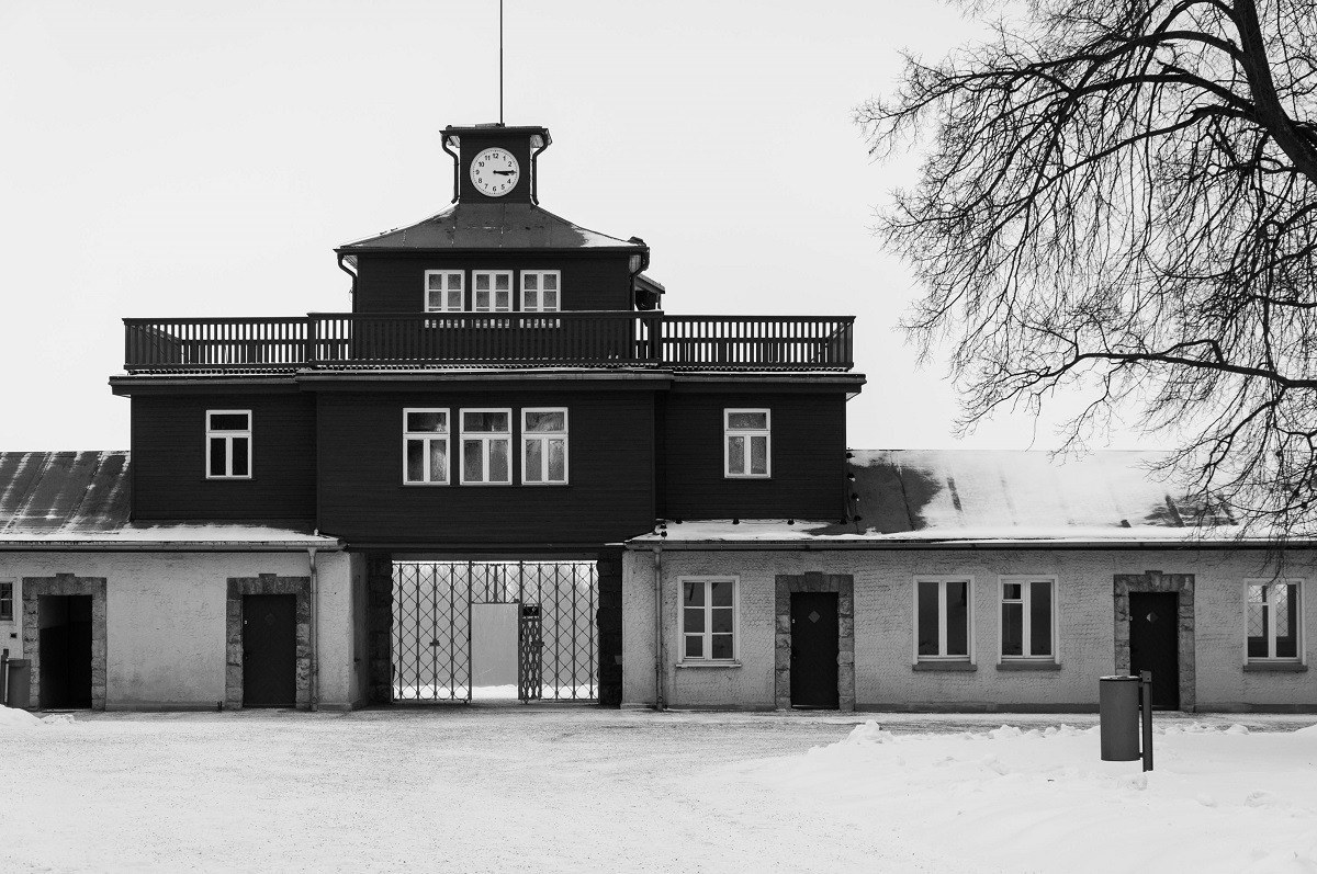 The main gate at Buchenwald with the clock stuck at 3:15 - the hour and minute of liberation.