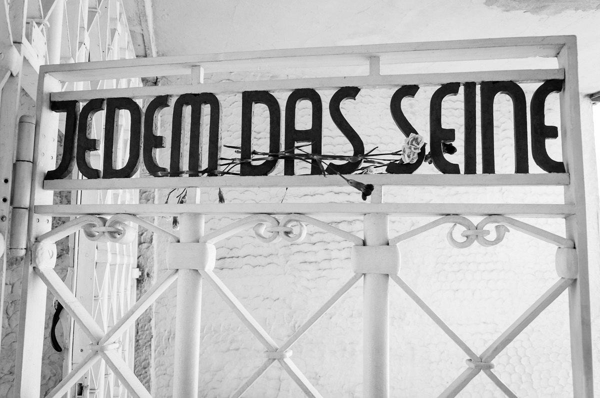 """The gate at the Buchenwald Concentration Camp reads """"Jedem das Seine"""" and means """"to each what he deserves."""""""