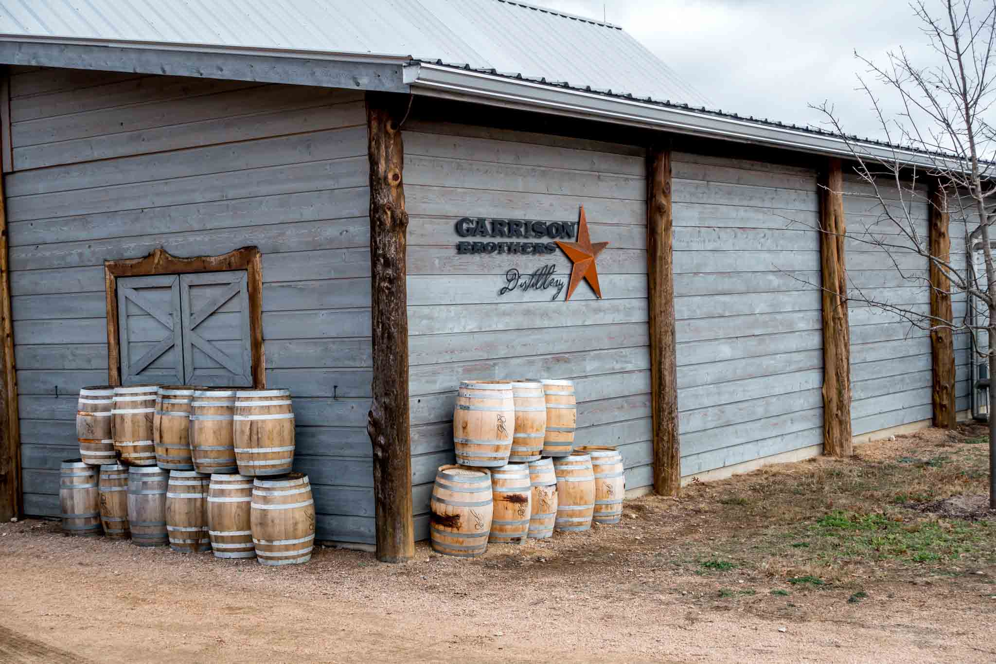 Barn with barrels at Garrison Brothers Distillery, one of the Texas distileries