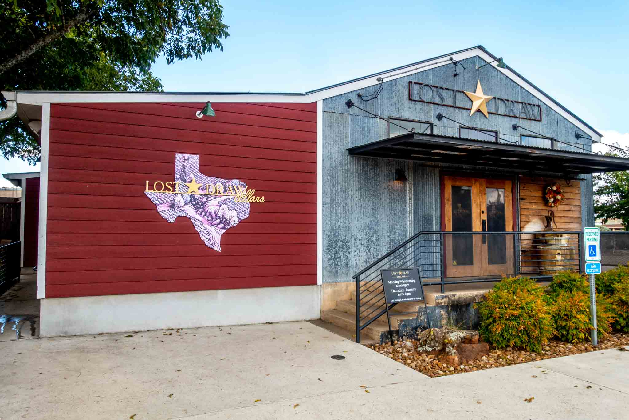 Lost Draw Cellars tasting room with Texas-shaped logo and signage