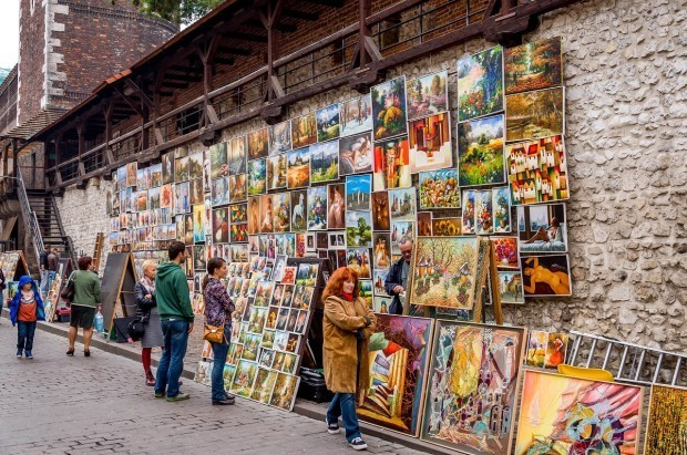 Artists selling their paintings inside the main gate off of Florianska Street in Krakow.