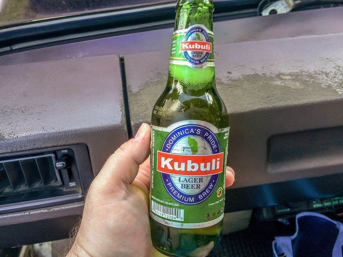 Enjoying the local beer in Dominica after a disappointing shore excursion to Titou Gorge, Trafalgar Falls and the Champagne Reef.