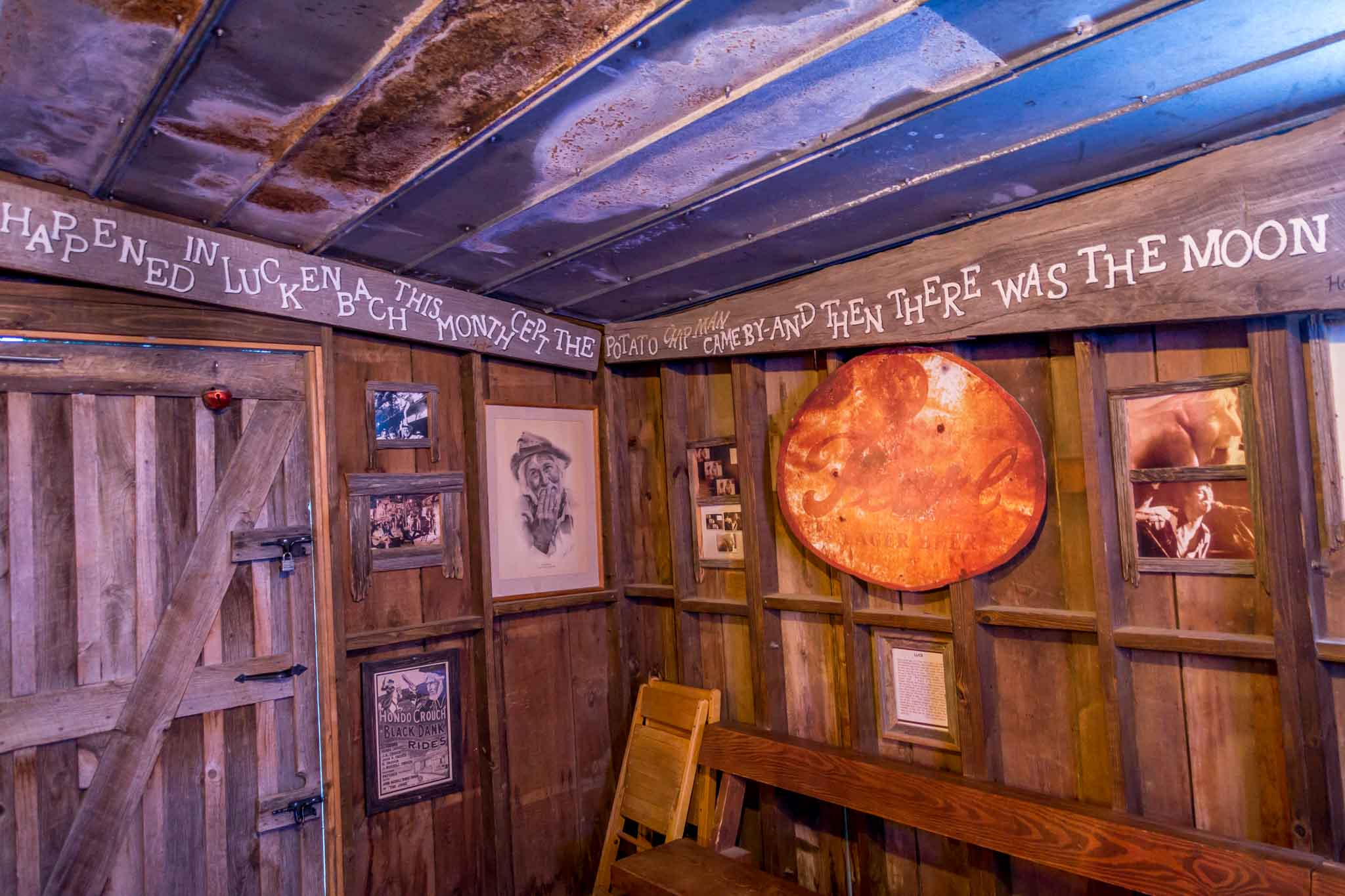 Verse from the poem Luckenbach Moon by Hondo Crouch on the wall in Luckenbach, TX