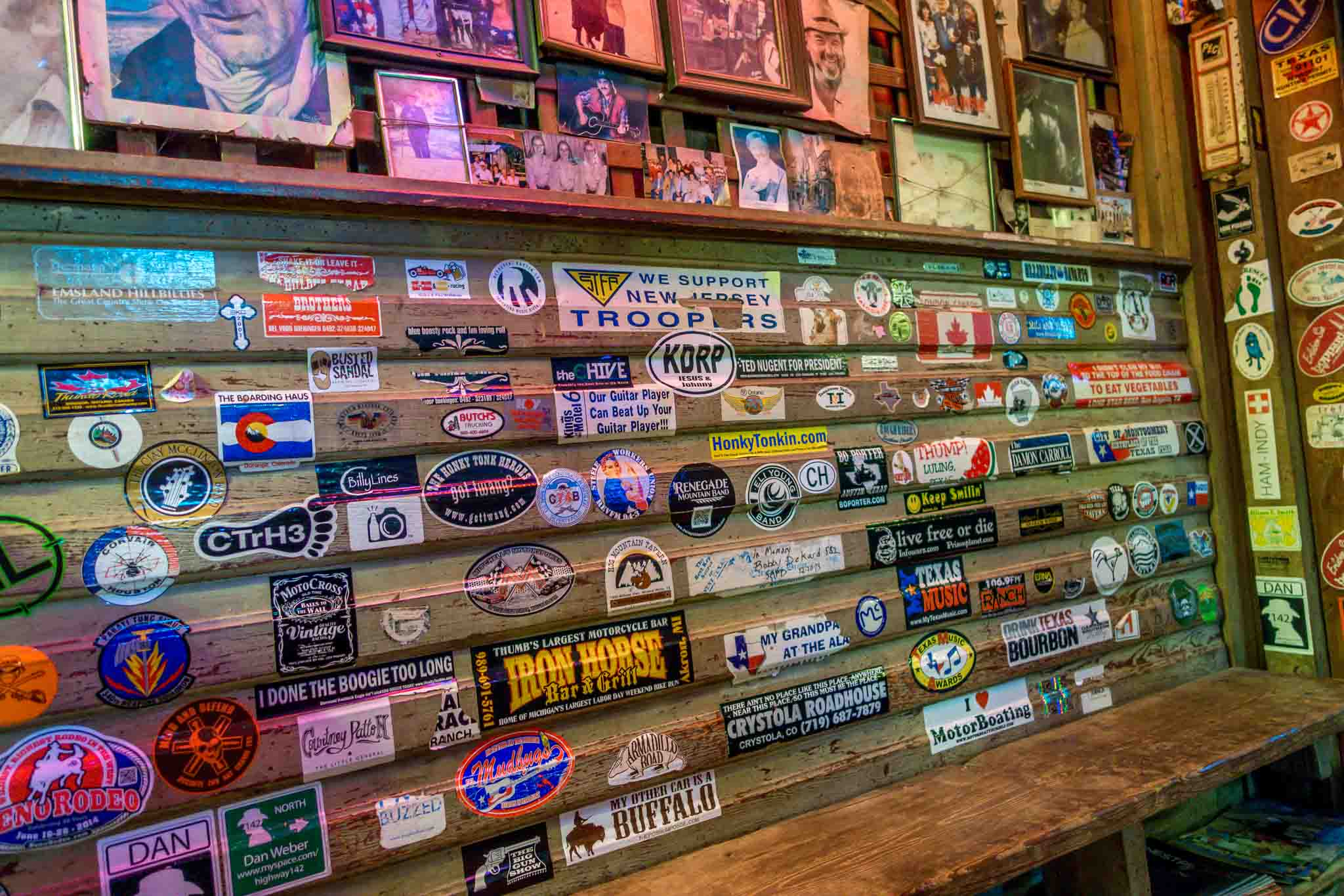 Bumper stickers on the wall at Luckenback Texas