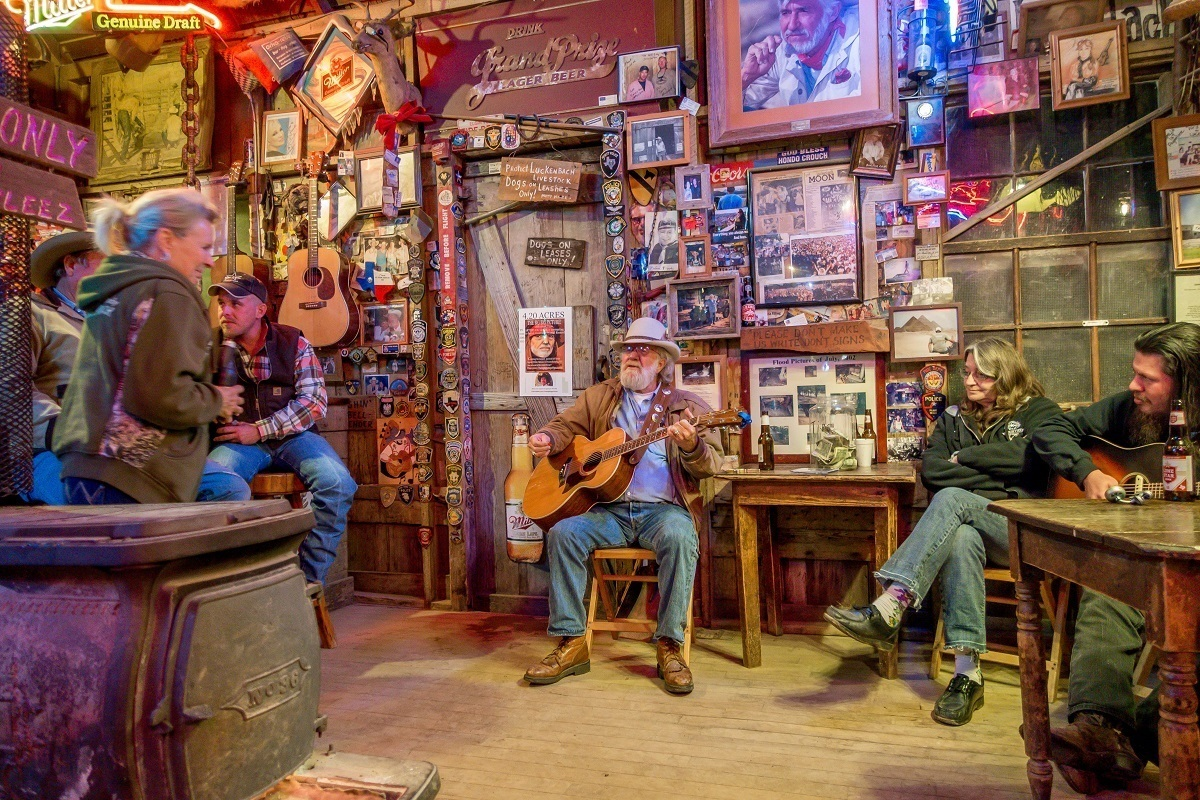 Country musician playing guitar in Luckenbach, Texas