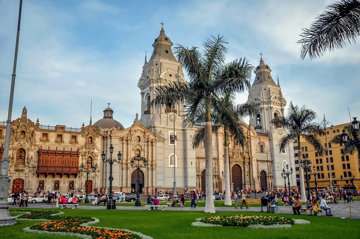 Cathedral, palm trees, and city square at Plaza Mayor in Lima, Peru